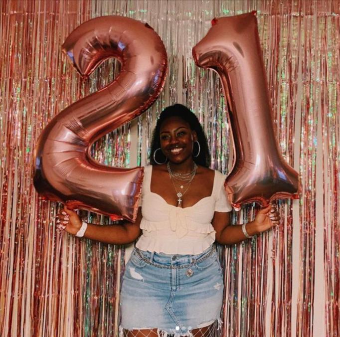 Niara turns 21 2021 holding big number balloons